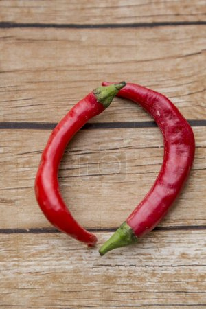Photo for Chili hot peppers on wood background - Royalty Free Image