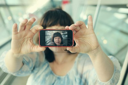 woman taking selfy picture