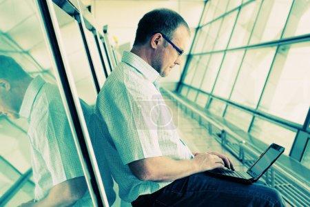 businessman in eyeglasses using laptop