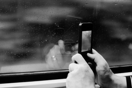 Photo for Close up man's hands using cellphone - Royalty Free Image
