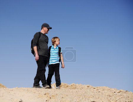 father and son in the desert