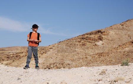 Boy hiking in the desert
