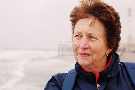 Senior woman on winter beach