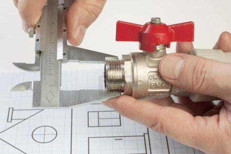 plumbing fixtures in man hands