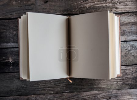 Photo for Old book on wood background - Royalty Free Image