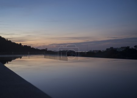 Silhouette of Phuket city during sunrise view from infinity pool