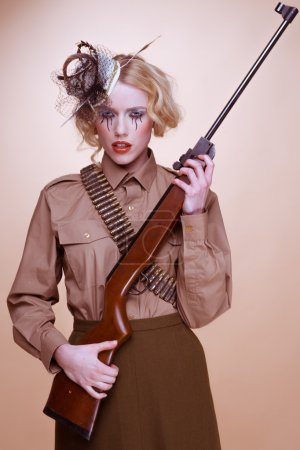 Fashionable Girl Scout Holding Rifle