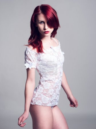 Photo pour Portrait of Seductive Young Woman, with Burgundy Hair, Wearing in See Through White Shirt, Looking at Camera. Isolated on Gray Background. - image libre de droit