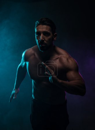 Silhouette Topless Athletic Man in a Fighting Pose