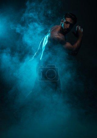 Silhouette Shirtless Muscled Man Posing in Smoke