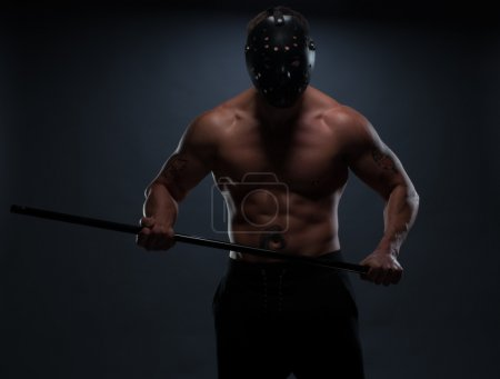 Silhouette Athletic Man with Helmet Holding a Bar