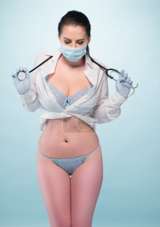 Sexy Female Physician with Mask and Stethoscope