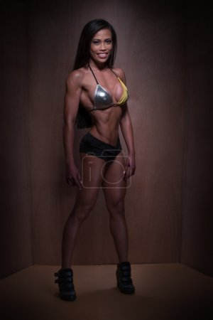 Bodybuilder Woman Posing in Sexy Fitness Outfit