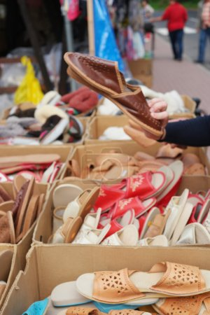 Display of summer shoes on a street market