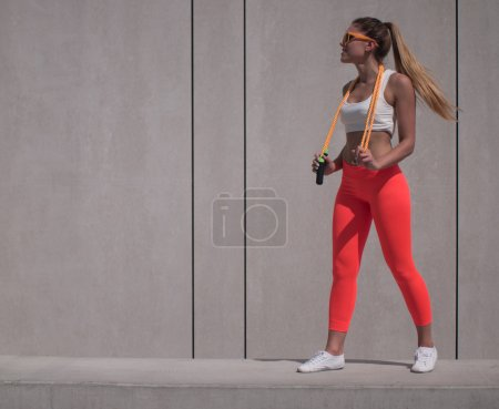 Fit Woman Holding Jumping Rope Over her Shoulders