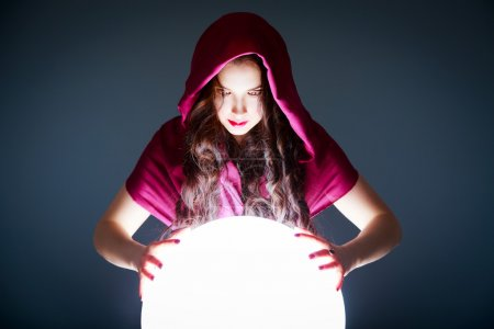 Photo for Fortune Teller Looking in a Magic Crystal Ball. Future Prediction. Beautiful Copy Space for your Logotype or Concept in the White Glowing Ball. - Royalty Free Image