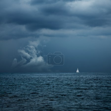 Boat Sailing in Center of Storm Formation