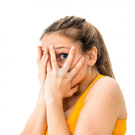 Woman hiding face laughing timid