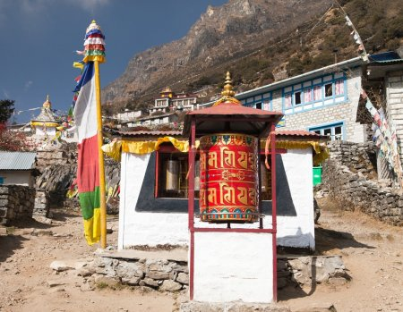 Thamo gompa with prayer flags and buddhist symbols