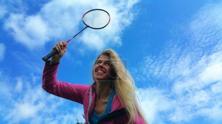 Blonde girl playing in badminton