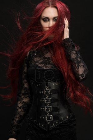 woman in black gothic costume