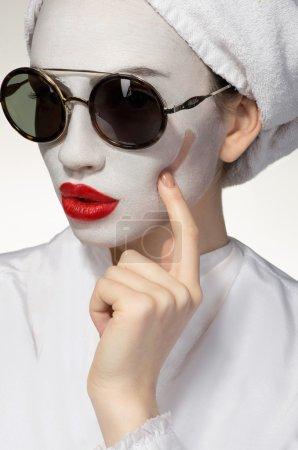 Woman with healing skin mask