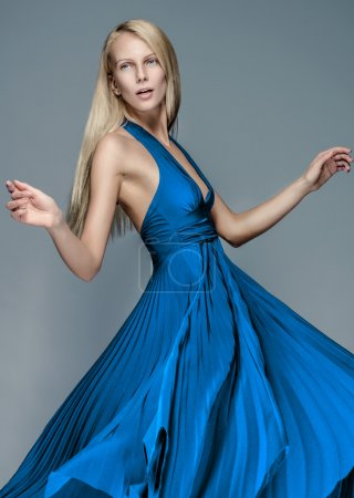 Photo for Pretty blond woman in beautiful blue dress - Royalty Free Image