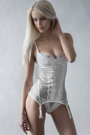 Sexy blonde woman in white lingerie...