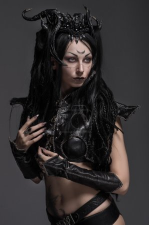 Photo for Woman dark elf warrior in black costume on gray background isolated - Royalty Free Image