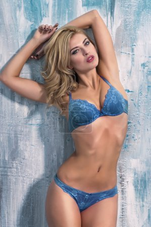 Blonde woman in blue lingerie