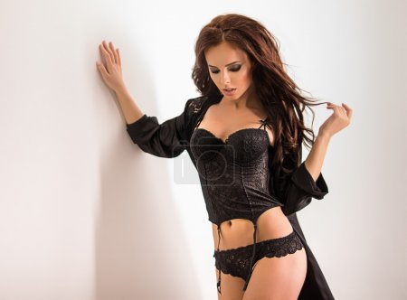 Woman in lingerie and black silk robe