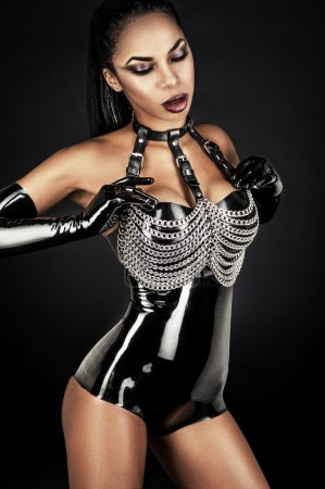 Woman in latex outfit with metal chains