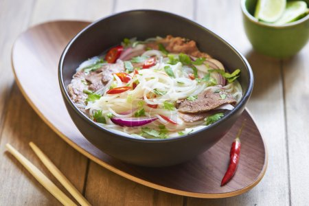 Photo for Pho bo, Vietnamese food, rice noodle soup with sliced beef - Royalty Free Image