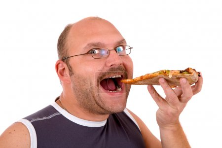 Photo for Man taking a bit bite out of his slice of pizza - Royalty Free Image