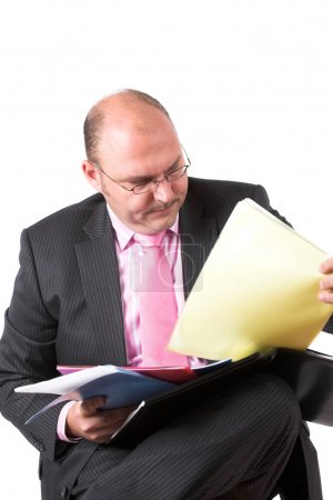 Businessman organizing his files