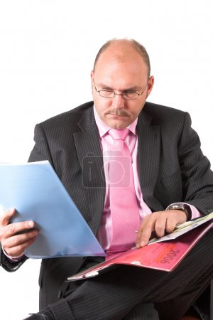 Businessmann looking at his papers