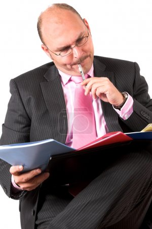 Businessman comparing his notes