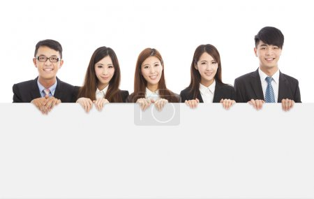 Asian young business people holding white board