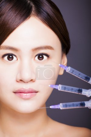 asian beautiful woman gets injection in her face. aesthetic medi
