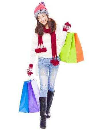 Beautiful happy young woman holding shopping bags.
