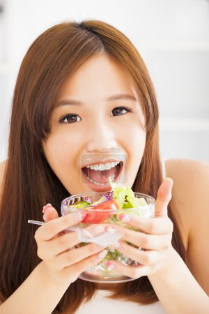 Photo for Beautiful girl eating healthy food salad - Royalty Free Image