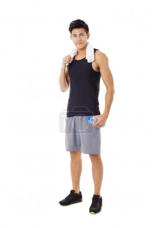 Photo for Full length  of smiling asian young  man - Royalty Free Image