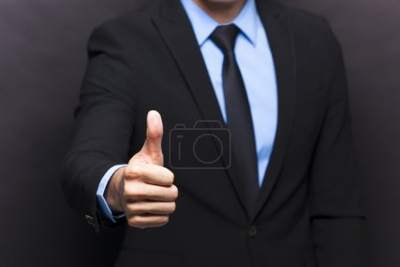Photo for Businessman showing thumbs up sign - Royalty Free Image