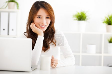 Smiling Young asian woman  with laptop...