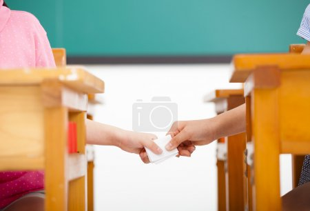 Students passing notes in the classroom