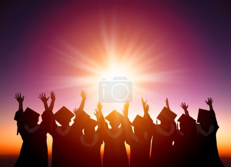 Silhouette of Students Celebrating Graduation watching the sunli