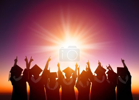 Photo for Silhouette of Students Celebrating Graduation watching the sunlight - Royalty Free Image