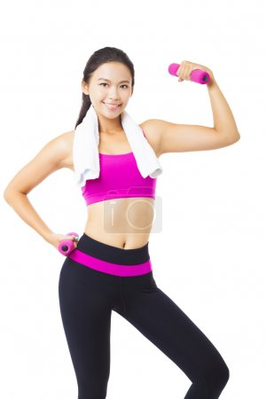 Photo for Happy young woman exercising with dumbbells - Royalty Free Image