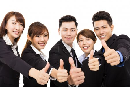 Smiling business people with thumbs up...