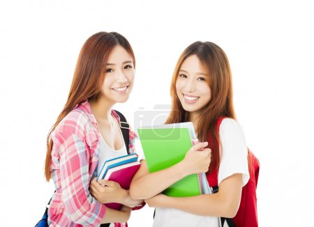 Photo for Two  happy teenage students girls isolated on white - Royalty Free Image